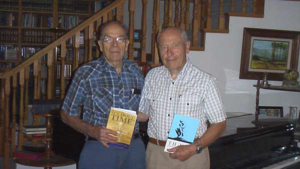 "Authors Chancey Riddle and David W. Allan sharing books. - ""Think Independently"" and ""It's About Time."""